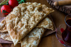 Turkish Cig Borek / Tatar Pie with minced meat and tea. Stock Images