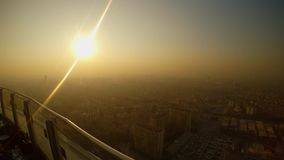 Turkish city of Konya in smog under the sun from a skyscraper height. KONYA / TURKEY - 11.20.2016 central streets of the ancient Turkish city stock footage