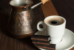 Turkish coffe pot with cup of coffe. The Turkish coffe pot with cup of coffe royalty free stock photo