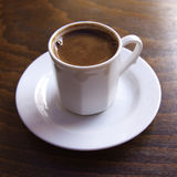 Turkish coffee. In white cup on the table Stock Photography