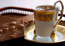 Turkish coffee. A cup of Turkish middle eastern coffee in a nice cup with chocolate bars Stock Photography