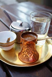Turkish coffee. Served in a traditional Turkish metal dish cap Stock Photos