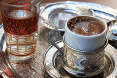 Turkish Coffee. Presented with a glass of water and Turkish Delight Royalty Free Stock Photo