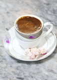 Turkish Coffee. A cup of Turkish coffee served with Turkish delight stock photo