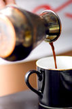 Turkish coffee. Being poured into a cup, shallow depth of field Royalty Free Stock Photo