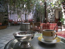 Turkish coffee. With cardomom served in traditional old house in Damascus, Syria Royalty Free Stock Photos