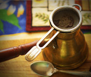 Turkish Coffee. Closeup of a traditional Turkish coffee maker or Arabic cezve (jezve) pot Stock Photos