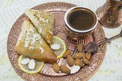 Turkish coffee, baklava and almonds Royalty Free Stock Images