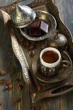 Turkish coffee. Beautiful bronze set for Turkish coffee on the old table Stock Photo