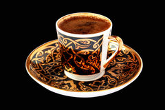 Turkish Coffee on black. Turkish Coffee in a traditional coffee cup. Isolated on black Royalty Free Stock Photo