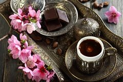 Turkish coffee, chocolate and branch with pink flo Royalty Free Stock Images