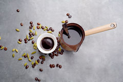 Turkish Coffee with coffee beans and Cardamom scattered on a vintage background Stock Photo