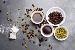 Turkish Coffee with coffee beans and Cardamom scattered on a vintage background Royalty Free Stock Photography