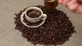 Turkish coffee and coffee beans. Pouring Turkish coffee and coffee beans stock footage