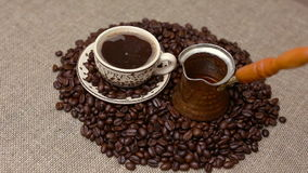 Turkish coffee and coffee beans. Pouring Turkish coffee and coffee beans stock video