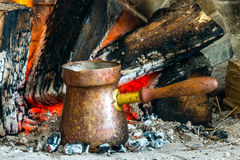Turkish coffee cooked over hot coals. Turkish coffee is ideally cooked over some hot coals that have burned for a long time and settled into ashes royalty free stock photo
