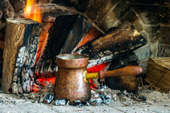 Turkish coffee cooked over hot coals. Turkish coffee is ideally cooked over some hot coals that have burned for a long time and settled into ashes royalty free stock images