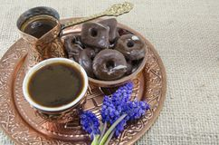 Turkish coffee with cookies and flowers Stock Photos