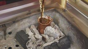 Turkish coffee cooking on embers. Traditional nubian coffee making. Coffee turk on the coal. Turkish coffee. Traditional nubian coffee making. Coffee turk on stock footage