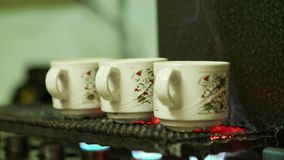 Turkish coffee cooking in the glasses. At Turkish cafe stock video footage
