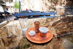 Turkish coffee in copper cezve with a piece of lok Stock Photo