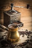 Turkish coffee in copper coffe pot royalty free stock photo