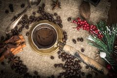 Turkish coffee in copper coffe pot. Turkish coffee in copper coffee pot on wooden background stock image