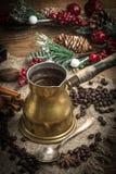 Turkish coffee in copper coffe pot. Turkish coffee in copper coffee pot on wooden background stock photo