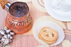 Turkish coffee in copper coffee pot with cookies Stock Photography