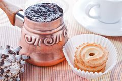 Turkish coffee in copper coffee pot and cookies Stock Photos