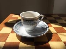 Turkish coffee cup on backgammon board royalty free stock photo
