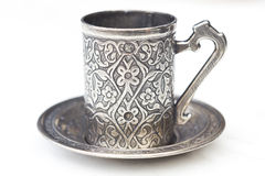 Turkish coffee cup. Empty turkish coffee cup with arabic decoration with metal cup and dish isolated on a white background Royalty Free Stock Photo
