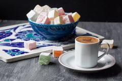 Turkish coffee and Turkish delight lokum in a blue bowl Stock Image