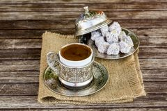 Turkish coffee and turkish delight. Turkish coffee with delight and traditional copper serving set royalty free stock photo