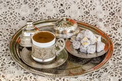 Turkish coffee and turkish delight. Turkish coffee with delight and traditional copper serving set stock images