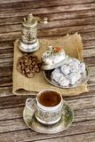 Turkish coffee and turkish delight. Turkish coffee with delight and traditional copper serving set stock photography
