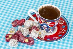 Turkish coffee and turkish delight. Turkish coffee with delight and traditional copper serving set royalty free stock photography