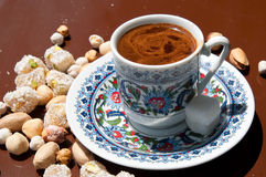Turkish coffee and delights. Cup of turkish coffee, sweet delights and peanuts Stock Photography