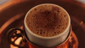 Turkish Coffee with foam in traditional glass  close up. Turkish Coffee in traditional glass stock footage