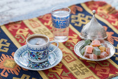 Turkish coffee with glass of water and turkish delights on tradi Royalty Free Stock Images