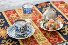 Turkish coffee with glass of water and turkish delights Royalty Free Stock Photography