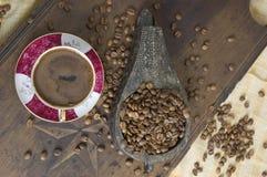 Turkish coffee - Greek coffee. Greek coffee with coffee beans Royalty Free Stock Photography