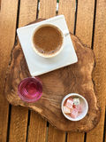 Turkish coffee. With Turkish honey served on a wooden tray view from above upright format Stock Photography