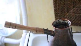 Turkish coffee. Making turkish coffee in cezve (ibrik stock footage