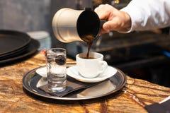 Turkish Coffee. Male hand pouring Turkish Coffee Stock Photo