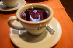 Turkish Coffee. Photo of Turkish Flag Reflection in a Cup of Coffee royalty free stock photos