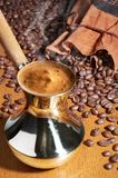 Turkish coffee pot. And coffee beans Royalty Free Stock Photos