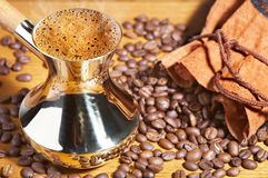 Turkish coffee pot. And coffee beans Stock Images