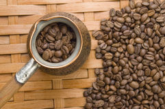 Turkish coffee pot. Turkish coffee pot and coffee beans Stock Photography