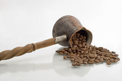 Turkish coffee pot. Turkish coffee pot and coffee grains on a white background Stock Photo